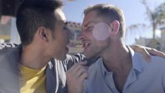 Cute Gay Couple Eat The Same Frie (From Opposite Ends), They Kiss, Then Laugh Stock Footage