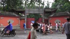 Pedestrian And Cars Outside Wenshu Monastery Chengdu China Stock Footage