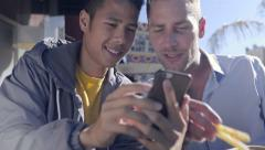 Stock Video Footage of Fun Gay Couple Take Selfies, Eat Fries At A Cafe In The Castro, San Francisco