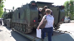 Curious people with children pose in military army vehicle tank. 4K Stock Footage