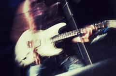 Rock guitarist vintage style photograph Stock Photos