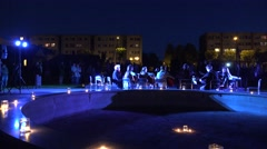 Band performance in evening town square with candle light . 4K Stock Footage