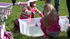 Kid play duck race game in water pool with straw. 4K Stock Footage