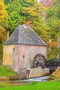 Old water mill in the Dutch province of Gelderland - stock photo