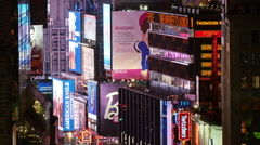 Variety of advertising signs on Broadway at night Stock Footage