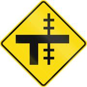 New Zealand road sign - Level crossing on uncontrolled T-junction on right - stock illustration