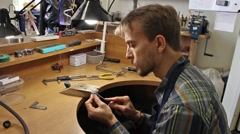 Man processes the surface of the billets for silver ring with a file(tool) Stock Footage