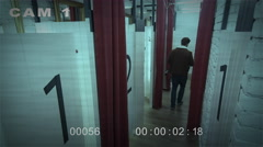 CCTV security cam footage of people in a fitting room in a department store Stock Footage