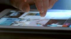Close up of fingers on tablet PC - stock footage
