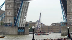 Sailing boats parading under tower bridge in London Stock Footage