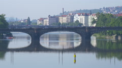 Legion Bridge reflecting in Vltava River, Prague Stock Footage