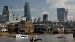 Thames River boat passes in front of The City of London Stock Footage