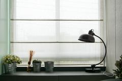 lamp on wooden desk - stock photo