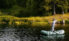 Fisherman in a pond Stock Photos