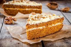 Piece of homemade carrot cake with walnuts Stock Photos