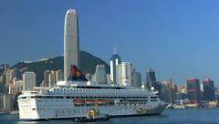 Cruise ship which departs from Victoria harbour in Hong Kong. Panning shot. Stock Footage