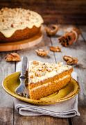 Piece of homemade carrot cake with walnuts - stock photo
