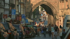 Walking near Lesser Town Bridge Tower on a sunny day, Prague Stock Footage