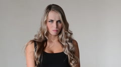 Frustration. Angry and stressed young woman on gray background Stock Footage