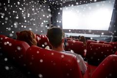 Couple watching movie in theater or cinema Kuvituskuvat