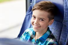 Stock Photo of happy boy sitting in travel bus or train