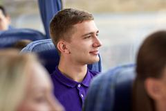 Stock Photo of happy young man sitting in travel bus