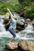 Sorty fit woman doing yoga asana Utkatasana - stock photo