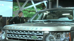 Chinese man in Land Rover, Beijing auto show Stock Footage