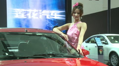 Lotus car, Chinese girl, Beijing Auto Show Stock Footage