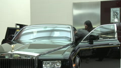 Chinese people, Rolls Royce Phantom, Beijing - stock footage