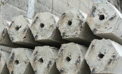 The pile of hexagon concrete foundation piles. Stock Photos