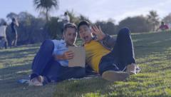 Gay Couple Hang Out In Park, Take Really Funny Photos Together With Tablet Stock Footage