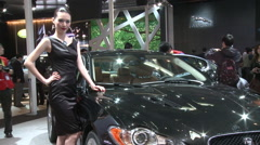 Chinese girl, Jaguar sportscar, Auto Show Stock Footage
