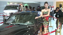 JAC cars, Chinese girl, Beijing auto show - stock footage