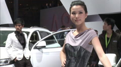 Chinese models posing at Beijing Auto Show Stock Footage