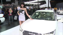 Crowds at Beijing Auto Show, Audi A4L car Stock Footage