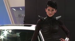 Beautiful Chinese girl at Auto Show Beijing Stock Footage