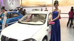 Chinese girl at Auto Show, Beijing, China - stock footage