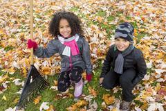 Stock Photo of Childs on the leaf season. The autumn season