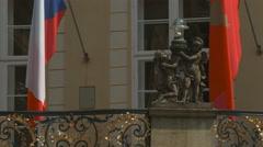 Little statues and flags on Archiv Pražského hradu building, Prague Stock Footage