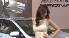 Chinese girl, Hyundai Verna car, Beijing Stock Footage