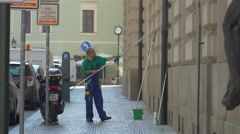 Man cleaning windows in Prague Stock Footage