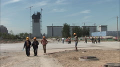 Construction workers at Water Cube, Beijing Stock Footage