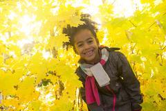 Child on autumn season portrait - stock photo