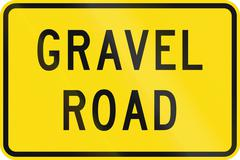 New Zealand road sign - Gravel road surface may be slippery - stock illustration