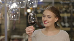 Beautiful young woman drinking wine Stock Footage