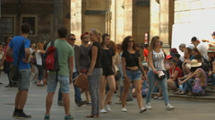 Young men and women walking in the Prague Castle Complex Stock Footage