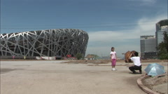 Birds Nest Stadium, taking photos, China Stock Footage