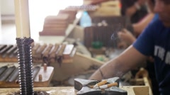 Manufacture of cuban cigars with tobacco leaves - stock footage