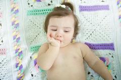 A cute little baby girl suck thumb - stock photo